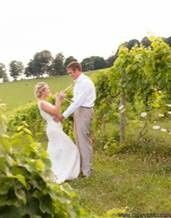 kissing in vineyard cropped