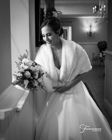 Natural window light making abeautiful image of the bride and her flowers