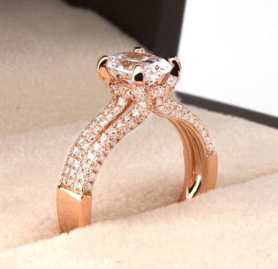 The romance of rose gold and an oval cut diamond, with the modern touch of a split shank.   18K Rose...