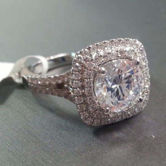 A glamorous double halo engagement ring from designer, Natalie K.   18K White Gold