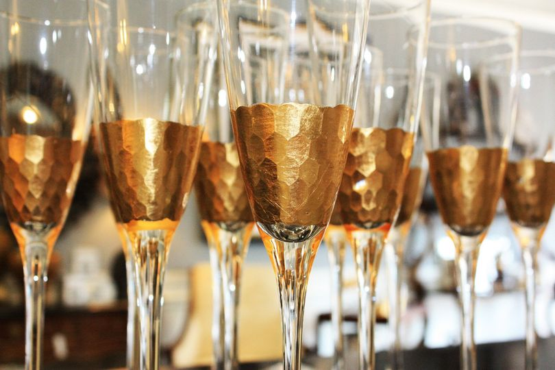Stunning gold leaf champagne flutes are the perfect way for the couple to toast their night and...