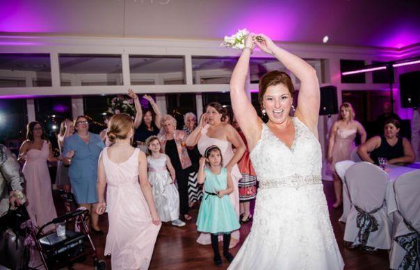 Bride throwing of bouquet
