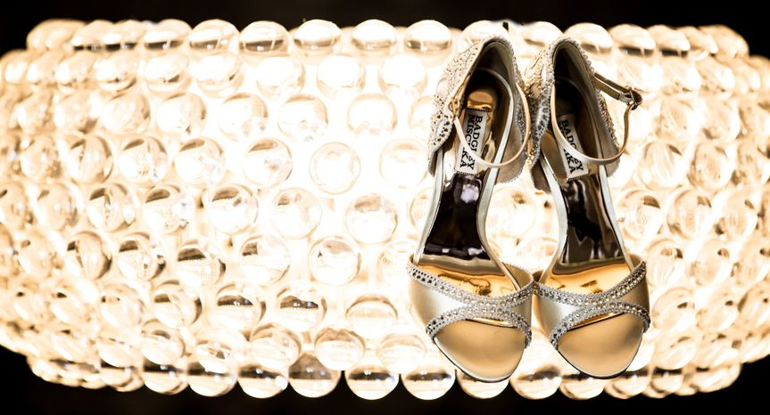 Beautiful detail shot of the bride's shoes on the chandelier at The Hyatt, Valencia