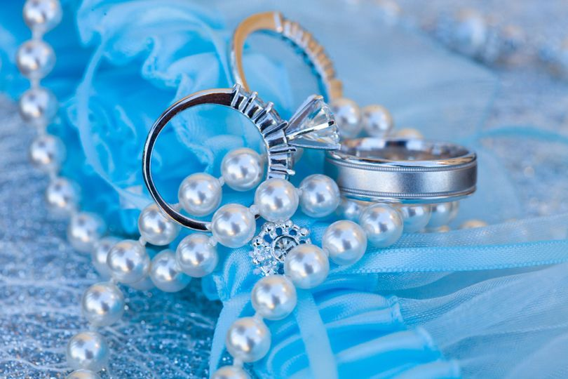 Detail shot of the rings and garter.