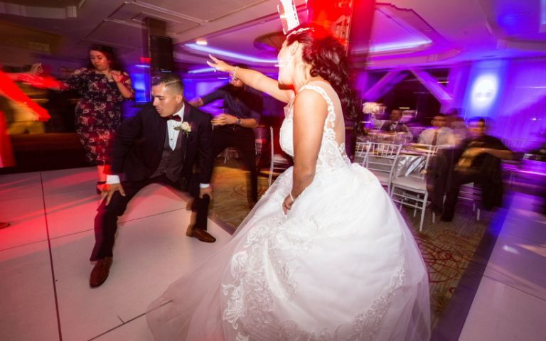 Bride and groom showing off their moves at their wedding reception