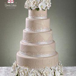 wedding cake blush with white flowers1 250x250