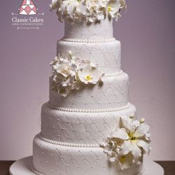 white quilted cake with white flowers 250x250
