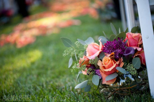 Table Centerpiece used to line ceremony aisle