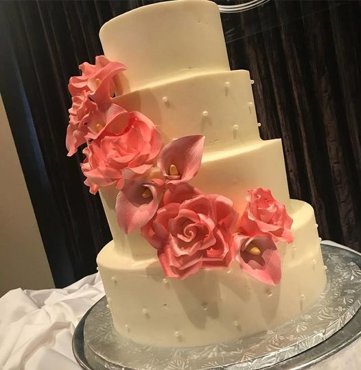 4-tier wedding cake with pink flowers