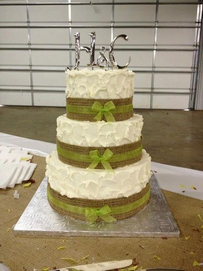 3-tier wedding cake with green ribbons
