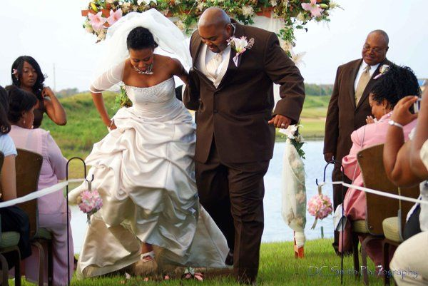 """Bride and groom """"jumping the broom"""""""