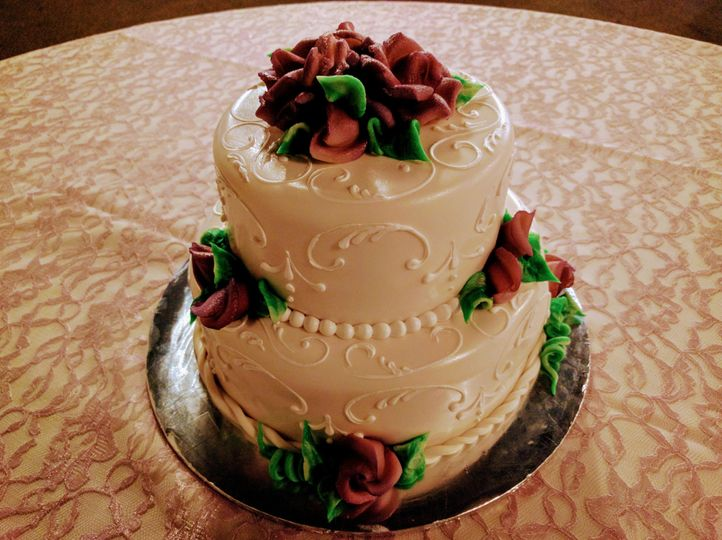 European Rolled Fondant wedding cake with marzipan roses, handcrafted by Mozart's co-owner and...