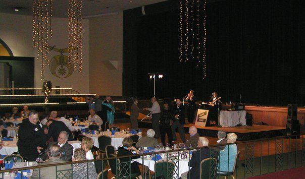 Ted and Jennifer on stage in the huge Main Ballroom at the Aladdin Shrine Center