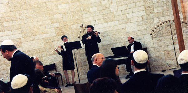 Ted plays a wedding ceremony at Temple Israel with flutist Cheri Papier and world-famous violinist...