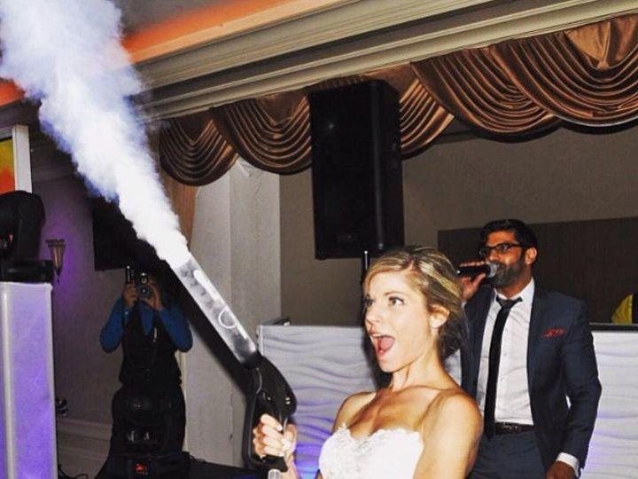Tmx Bride At Her Wedding Celebrating With Co2 Special Effects Gun From Cryofx 51 776248 V1 Raleigh, NC wedding dj