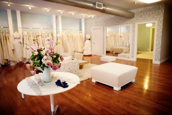The Modern Trousseau New York selection of beaded belts in the foreground and changing area in the...