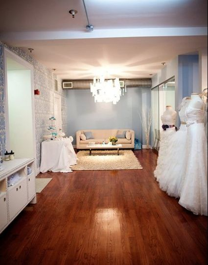 The Modern Trousseau New York reception area featuring a chandelier decorated with thank you notes...