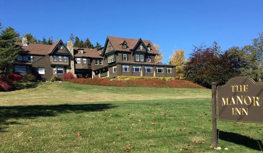 Manor exterior with large lawn