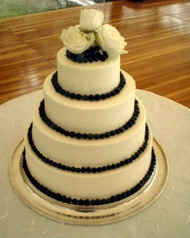 This is a four tier buttercream lined in blueberries!