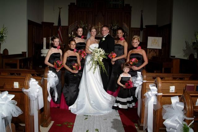 Newlyweds with the bridesmaids and flower girl