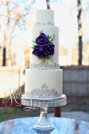 """This wedding cake is four tiers: 8"""", 6"""" (double barrel - tiers), and 4"""". Sugar roses and edible..."""
