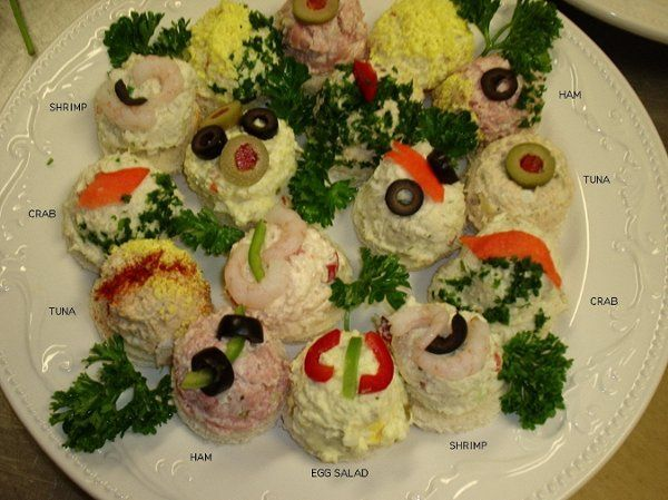 This delightful, open-faced and individually decorated finger sandwich assortment includes crap,...
