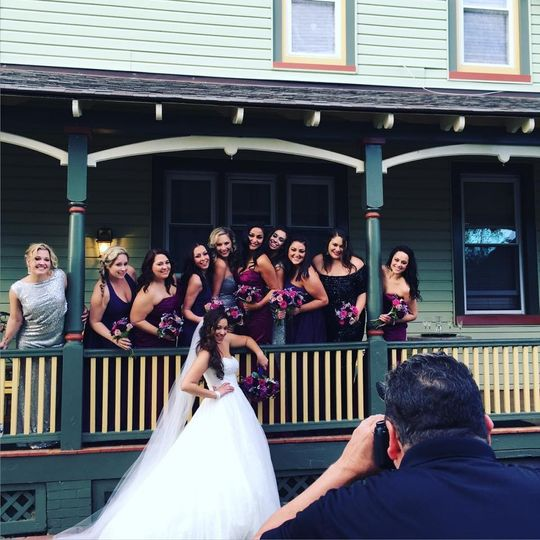 Behind the scenes photo of bridal party and bride