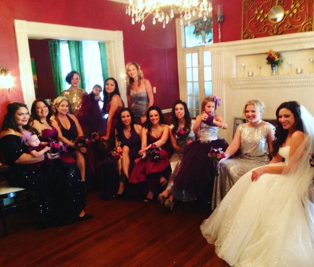 Behind the scenes photo of bride and bridal party