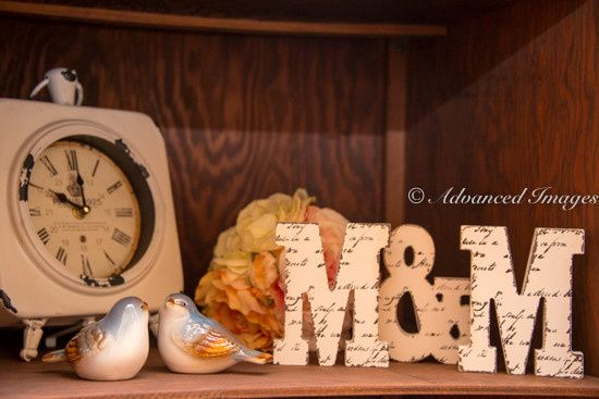 Lovebird figurines, clock, and initials
