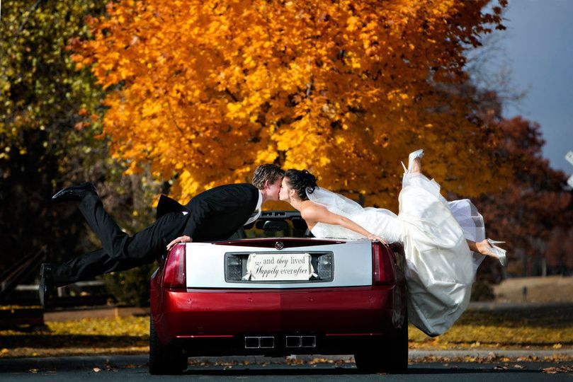 6a5f2513732e0a94 1461362700978 bride groom kissing over a cadillac convertible