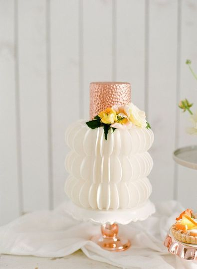 Wedding cake with a touch of rose gold on top