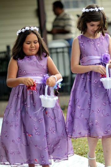 Flower girls.... Our weddings are photographed documentary style.