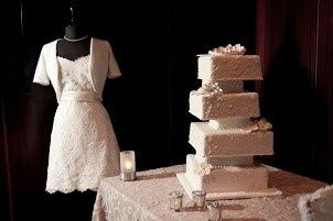 Off-set tiers with hand-piped lace design and hand-made edible flowers. Photo courtesy of Carter...