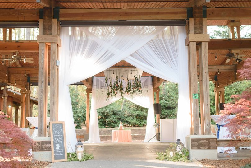 Draping and custom chandelier | Photo Credit: Eric & Jamie Photography