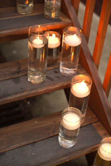 Candlelit inside the tall glass