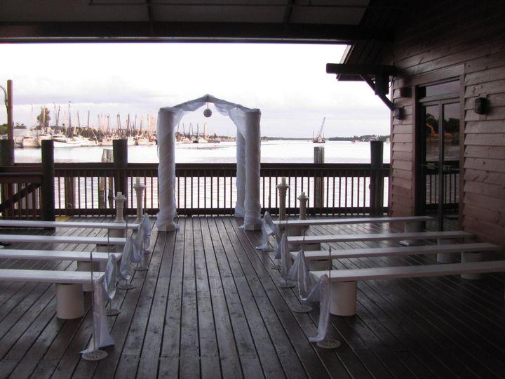 Tmx 1442534635351 Patioceremonywhitebenches1 Fort Myers Beach wedding venue