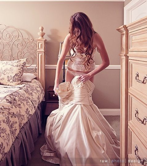 Gorgeous ivory corset set goes great with this strapless bridal gown.  Image by Raw Photo Design
