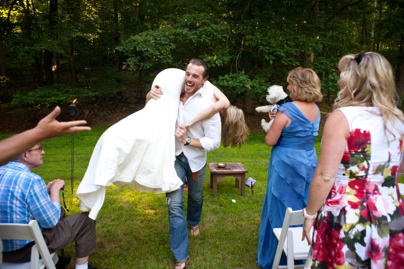 This groom did something quite unexpected at the end of their ceremony.  He literally scooped his...