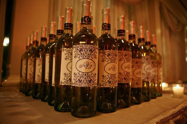 Wine bottles with custom-made labels on them for each guest