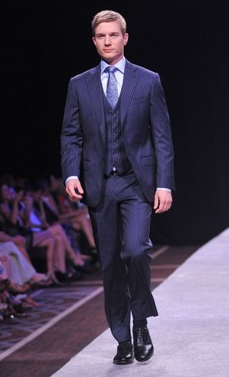 A less-formal but no less put-together look is the 3 piece suit. Featured here with a two-button...