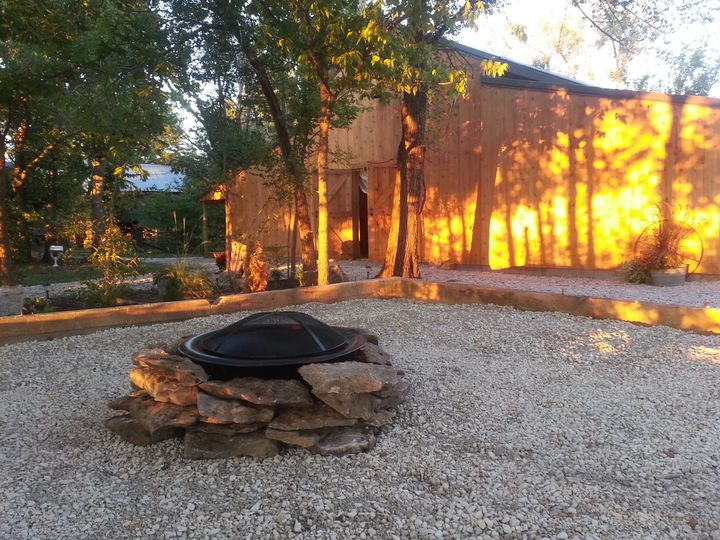 A fire pit is available for use for s'mores at receptions. Bench seating is provided around the pit.