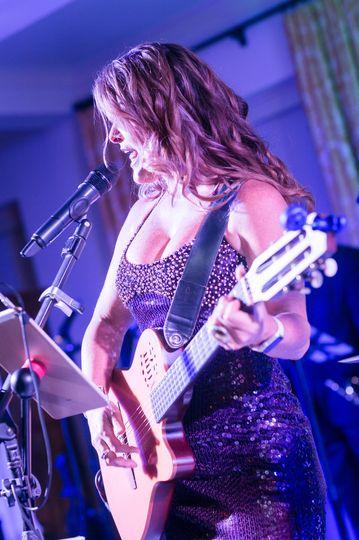 Yelba with guitar