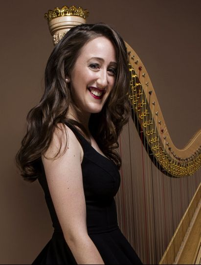 Lovely girl besides a harp