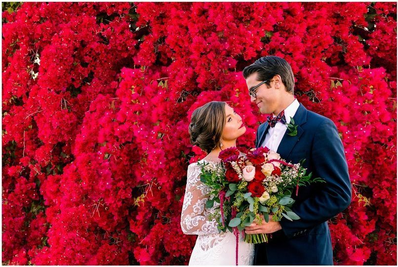 Bride and Groom on Floral Wall