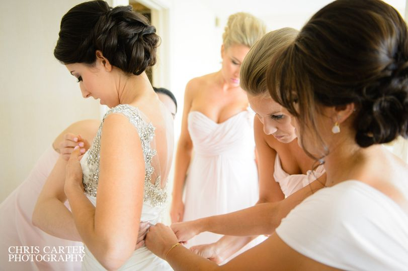 Helping the bride with the dress