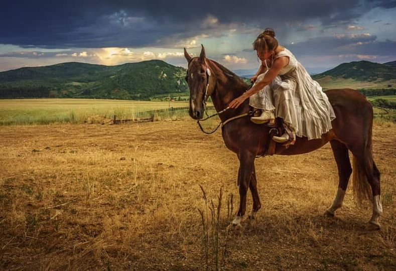 Our brides can arrive side saddle - ask us!