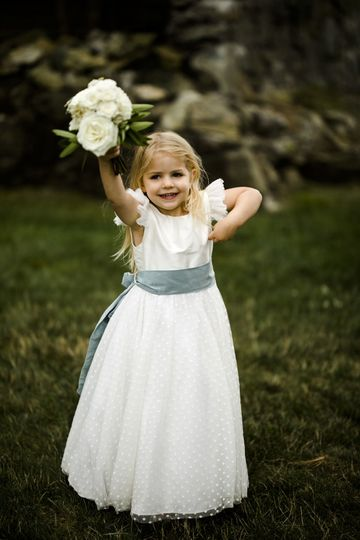 Flower girl with her bouquet
