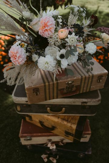 Flowers on top of suitcases