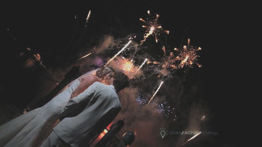 bride kiss fireworks