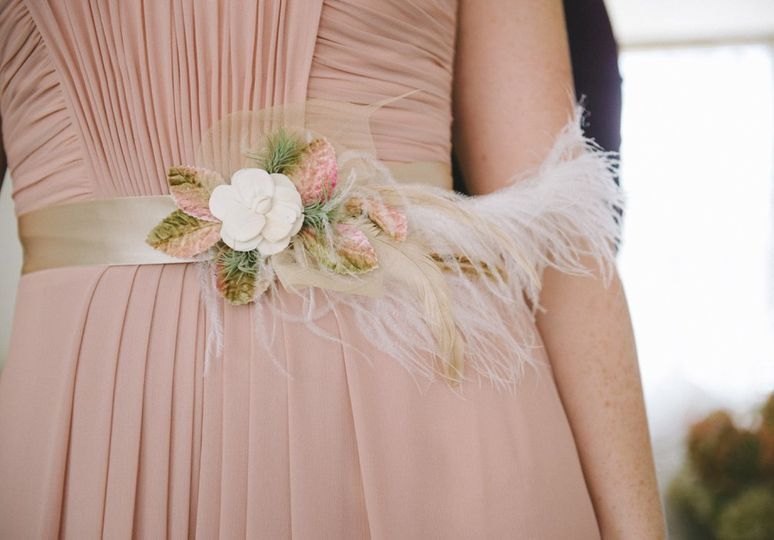 Bridal sash with ostrich feather and succulents.  Photo by Nathan Russell Photo.